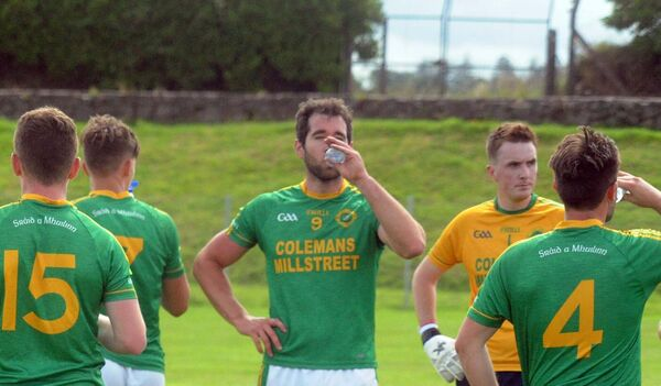 Millstreet players during a water break against St. Finbarr's in the Bon Secours Cork IAFC at Carrigadrohid. Picture: Denis Minihane.