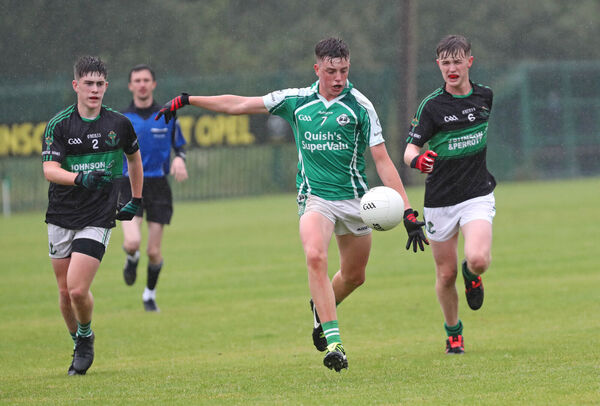 Darragh Egan and Jack Scally, Nemo Rangers, close in on Harry Aherne, Ballincollig. Picture: Jim Coughlan.