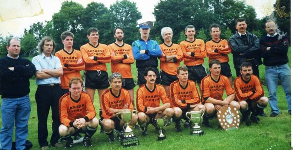 Business League: Youghal Yarns, the quadruple winners 1992/93. Back: Timmy Murray, Seamus Cody, Sean Twohig, Greg Cooney, John Bowen, Bernard O'Sullivan, Laurence Murphy, Connie Hosford, Willie Griffin, Dave Golden, Timmy Houlihan. Front: Denis Crowley (Cork Youth League), Dave O'Mahony (newly appointed Harp Celtic manager), Alan Costello (c), Alex O'Regan, Brian McCarthy, Denis McCarthy.