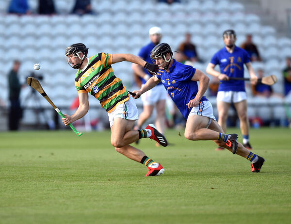 Glen Rovers' Simon Kennefick breaks from St Finbarr's John Neville to score the opening goal. Picture: Eddie O'Hare