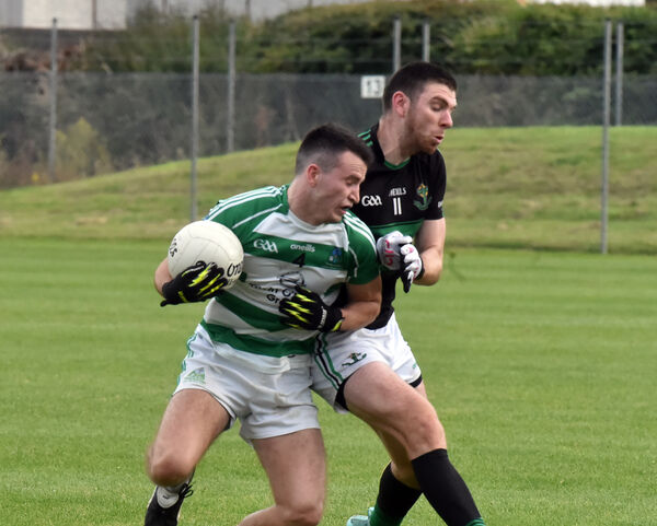 Valley Rovers' Aaron Lyons is tackled by Nemo Rangers' Luke Connolly. Picture: Eddie O'Hare