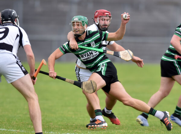 Douglas' Eoin Cadogan is tackled by Ballyhea's Pa O'Callaghan. Picture: Eddie O'Hare
