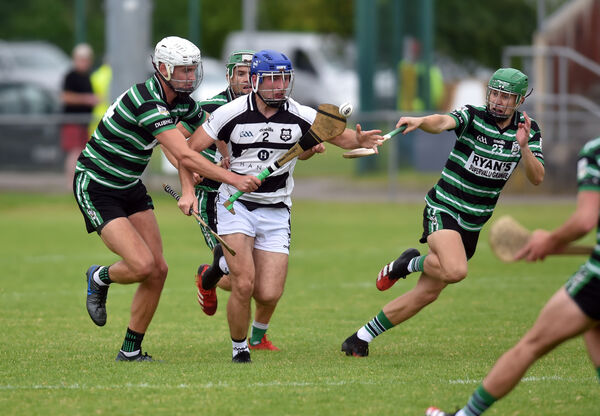 Ballyhea's Kevin Copps is tackled by Douglas' Shane Donegan, Alan Cadogan and Andy O'Connell. Picture: Eddie O'Hare