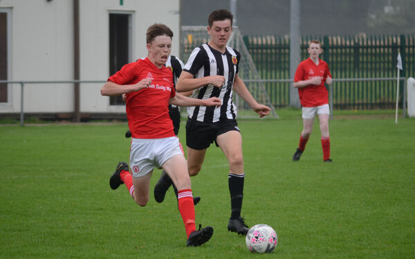 Alex Moloney of Midleton and Cian McGree of Keadue Rovers chase after a loose ball during the SFAI Skechers U15 National Cup game at Knockgriffin Park. Picture: Howard Crowdy