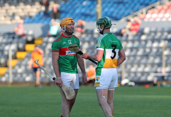 Brian Murphy, Bride Rovers, Declan Dalton, Fr. O'Neills, exchange words after both received a yellow card. Picture: Jim Coughlan.