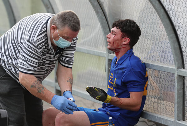 Colm Scully, St Finbarr's, receives treatment for a blood injury. Picture: Jim Coughlan.