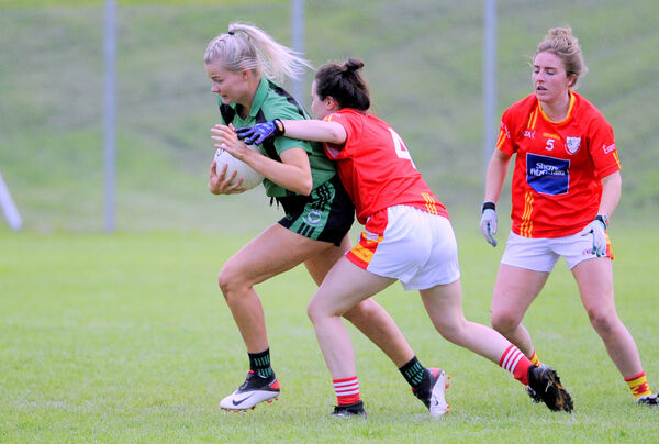 St Val's Ciara McCarthy under pressure from Hannah Hickey. Pic: Gavin Browne