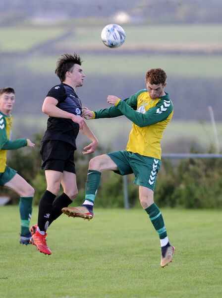 College Corinthians' Colin O'Mahony and Rockmount's Kevin O'Connell jump for the ball. Picture: Gavin Browne