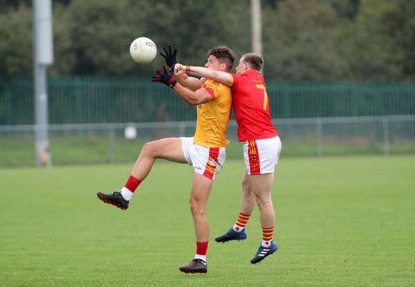 Colm O'Callaghan, Éire Óg, contesting a dropping ball with Mattie Taylor, Mallow. Picture: Jim Coughlan.