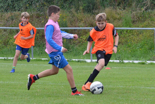 Adam Jeffers and Daniel O'Mahony seen in action during one of the matches at the Crosshaven AFC soccer camp in 2019. Picture: Howard Crowdy