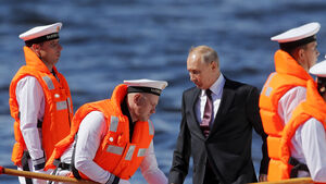 Putin attends naval parade and promises new ships