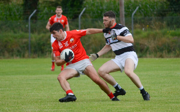 Kevin Davis of O'Donovan Rossa pulls away from Alan Hosford of St Nicholas during the Cork Senior Football Championship match in Brinny. Picture: Howard Crowdy