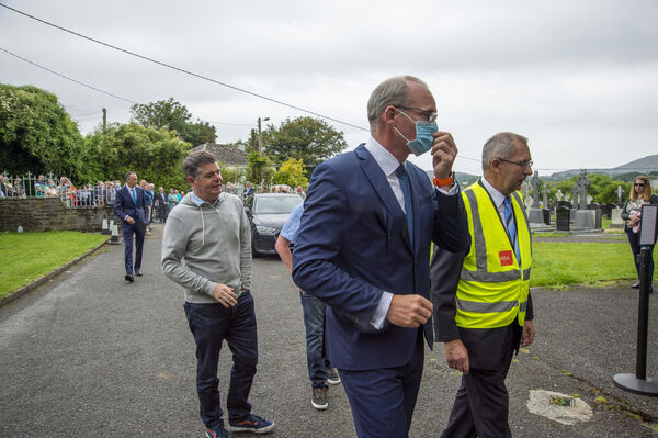 Simon Coveney T.D. Deputy Leader of Fine Gael and Minister for Foreign Affairs and Minister for Defence with Pascal Donoghue, Minister for Finance at the Requiem Mass for the late P.J. Sheehan. Picture Dan Linehan