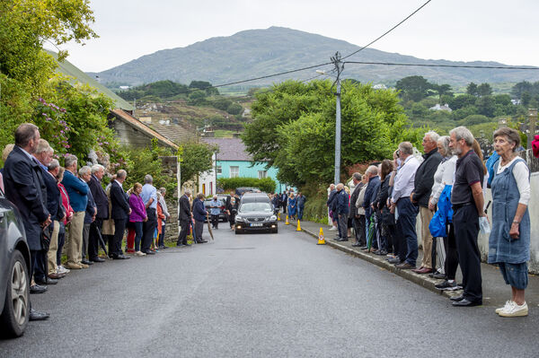 The funeral cortège of the P.J. Sheehan followed by his family members Diarmuid, Deirdre, Eucharia (O'Mahony) and Maebh (O'Connor) arriving in Goleen for Requiem Mass in the Church of Our Lady, Star of the Sea and St Patrick's. Picture Dan Linehan