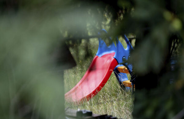A children's slide can be seen on the grounds of an allotment garden plot in Seelze, near Hannover, Germany. Picture: Peter Steffen/dpa via AP