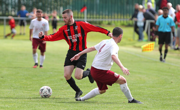Anthony McAlavey, Ringmahon Rangers, takes on Terry McAuley, Killester Dunnycarney. Picture: Jim Coughlan.
