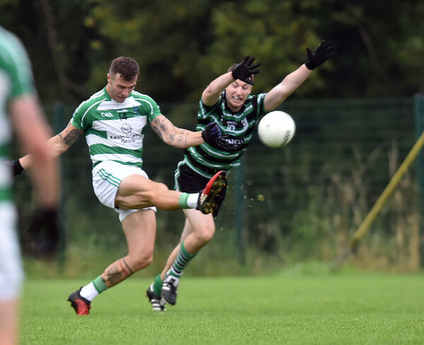Valley Rovers' Fiachra Lynch kicks over a point from Douglas' Eoin Cotter. Picture: Eddie O'Hare