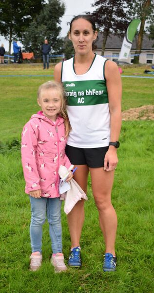 Jennifer Goggin-Walsh, winner of the senior 3000m at the East Cork track championships, pictured with her daughter Isobel. Picture: John Walshe