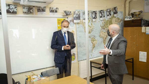 Taoiseach Micheál Martin (left) and Deputy Principal, Nicholas O'Keefe (right), at Nagle Secondary Community College, Mahon in Cork. PA Photo.