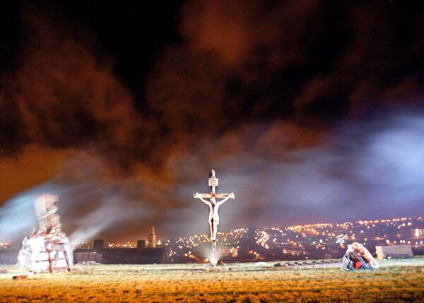 HIGHLIGHT: The corcadorca theatre group's 2000 passion play 'The Trial of Jesus' reaches it's dramatic finale at bell's field above cork city on Good Friday night.
