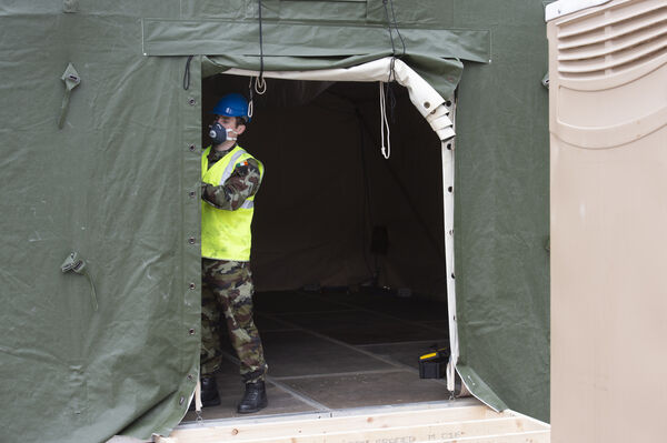Private Stephen Crowley working outside the Mercy Hospital, Cork, where the army and navy have erected a temporary staff screening tent centre. Picture Dan Linehan