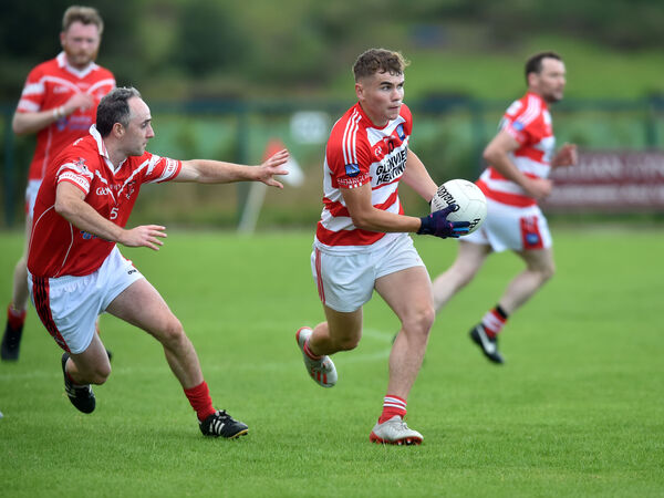 Adrigole's Seanie O'Sullivan breaks from Mayfield's Colm O'Neill during the Bon Secours Cork IAFC at Inchgeela. Picture: Eddie O'Hare