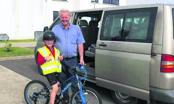 FUND-RAISING CHALLENGE: Harry O'Hanlon and Sonas bus driver Paddy. Harry is cycling 3km each day over a duration of 33 days in his fund-raising trek.