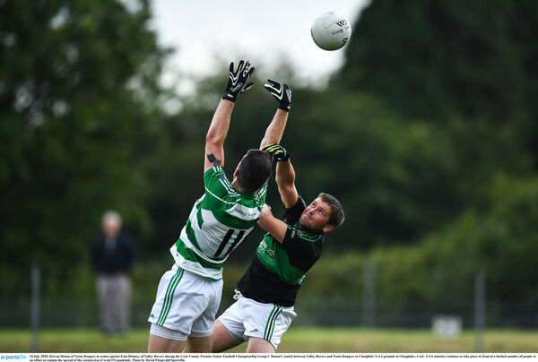 Kieran Histon of Nemo Rangers in action against Eoin Delaney of Valley Rovers. Picture: David Fitzgerald/Sportsfile