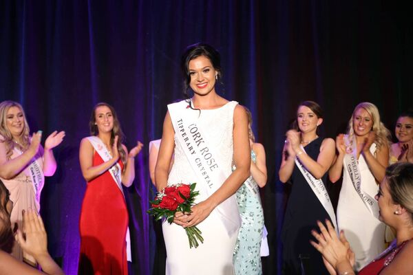 Cork Rose Stephanie McCarthy picking up her sash. Picture: Will Nolan