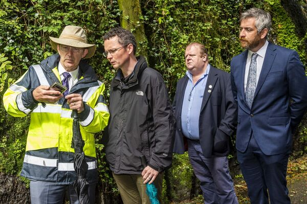 Minister for the Office of Public Works, Patrick O'Donovan TD pictured with Ezra MacMannaman, OPW, Cllr. Danny Collins and Christopher O'Sullivan TD (FF) at the site of Wednesday's flood breach in The Cutting'.  Picture: Andy Gibson