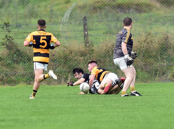 Castletownbere's Gary Murphy is brought down by Na Piarsaigh's Luke Murphy for a penalty during the Bon Secours Cork PIFC. Picture: Eddie O'Hare