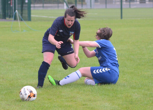 Lakewood's Valerie Leahy feels the pain from Wilton's Emma O'Driscoll's tackle. Picture: Howard Crowdy