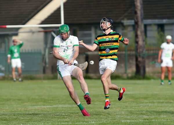 Anthony Kidney, Passage, battling Ryan McGuickan, Glen Rovers. Picture: Jim Coughlan.
