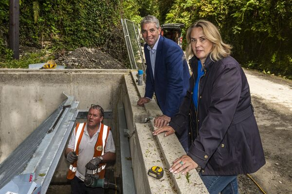 Senator Tim Lombard and Cllr. Karen Coakley inspect the repairs being done to the culvert in 'The Cutting' in Skibbereen after last night's floods. A contractor is installing 'trash screens' to prevent drains becoming blocked. Credit: Picture: Andy Gibson