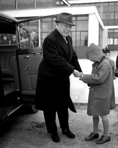 Charlie Chaplin signs an autograph at Cork Airport in 1964.