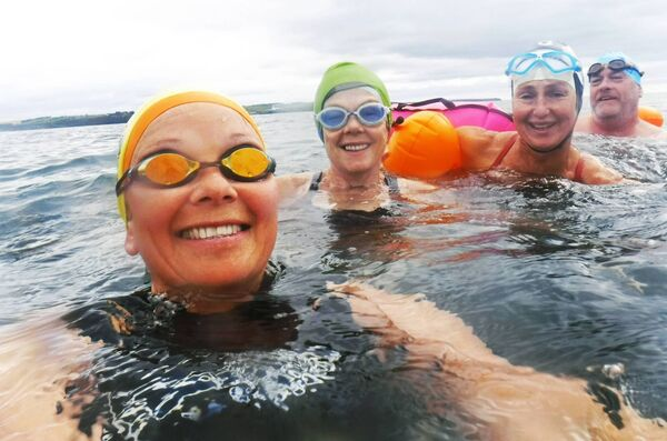 Siobhán Russell, Noreen Desmond, Maura Duffy and Bernard Kelleher, swimming to the Dutchman's Rock, Fennell's Bay. Picture: Siobhan Russell.