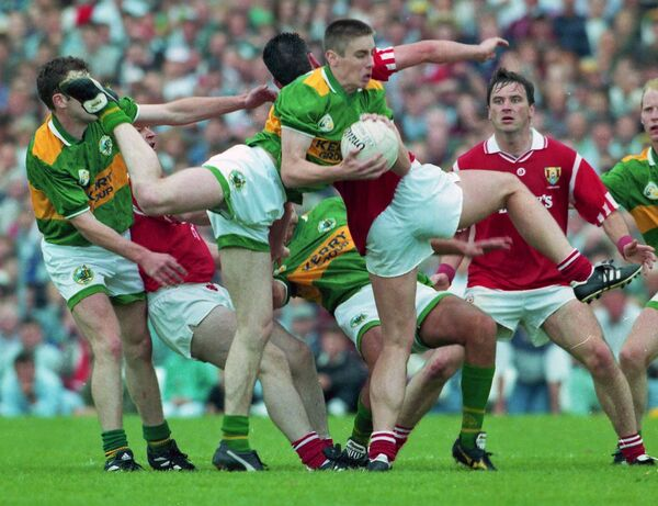 Kerry's Darragh Ó Sé battling Cork in the 1995 Munster football final at Fitzgerald Stadium. Picture: INPHO/Lorraine O'Sullivan