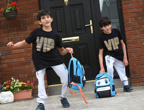 Returning to school at Midleton Educate Together, Co Cork are Benhaffaf twins Hussein and Hassan Benhaffaf.Pic; Larry Cummins.