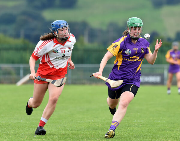 Finola Neville, St. Catherine's winning this ball from Ballygarvan player Cliona O'Leary during their S E Systems senior camogie championship match at Castle Road, Cork. Picture Dan Linehan