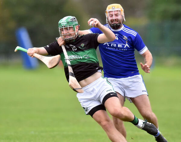 Nemo Rangers' Conor Horgan is tackled by Brian Dillon's Dylan O'Donoghue during the Sports Turf Solutions Seandún JAHC at Ballinlough Picture: Eddie O'Hare