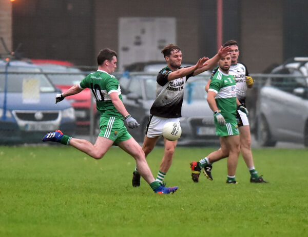 Macroom's Sean Kiely shoots from Gabriel Rangers' Richard Moynihan. Picture: Eddie O'Hare