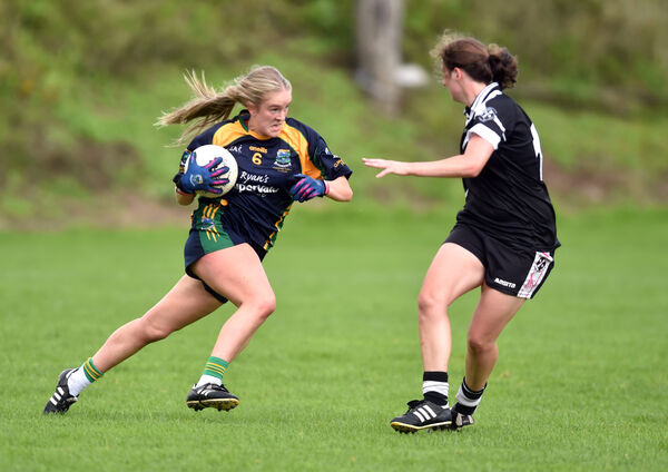 Kayla O'Connor bursting past Donoughmore's Rose O'Mahony. Picture: Eddie O'Hare