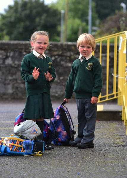 First day at school for junior infant pupils arriving at Scoil Iosaf Naofa, Ballintemple NS, Crab Lane, Cork on Thursday 27th August 2020.Twins Elsa and Freddie Vernon wait in line in the school yard before entering their classroom.Coronavirus covid-19 global pandemic 2020.Pic; Larry Cummins