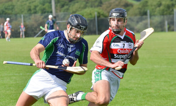 Eoin Burke of Valley Rovers holds possession ahead of Ballincollig's JP Murphy last season. Picture: Howard Crowdy