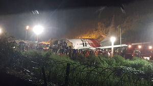 At least 16 dead and dozens injured after plane skids off runway in India