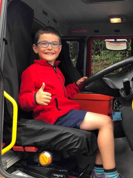 Harry O'Hanlon fulfilling his dream of sitting in a fire truck during one of his cycles raising vital funds for Shine Centre for Autism, Sonas Special Primary Junior School and The Rainbow Club Cork.