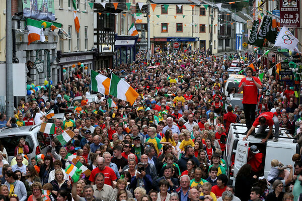 Fans line the streets during a homecoming parade in Skibbereen for the O'Donovan brothers. Picture: Brian Lawless/PA Wire.
