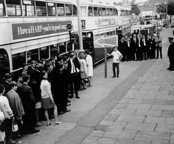 ALL ABOARD: People queuing up for the special busses at Grand Parade, Cork taking them to the Dixies at the Majorca Ballroom, Crosshaven in 1968.