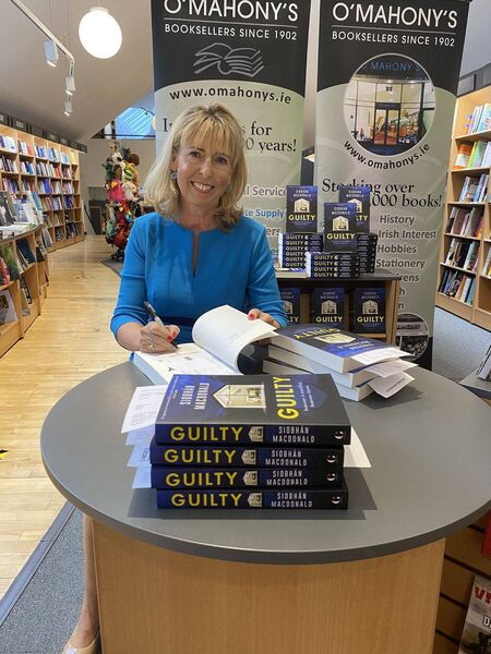 Siobhan MacDonald signing her new book.