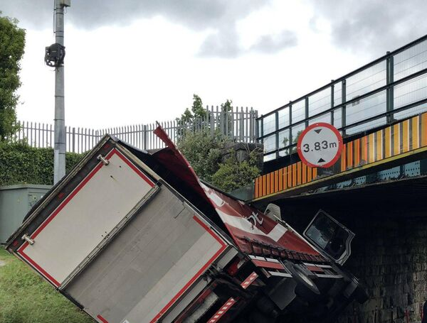 Truck partially overturned and stuck at the railway bridge on Dublin Hill. Picture: Dan Linehan